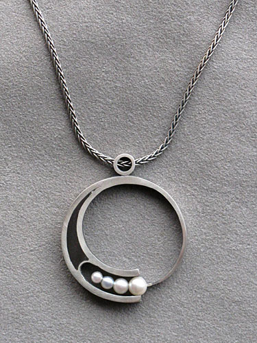 Pendant, silver and ebony with pearls