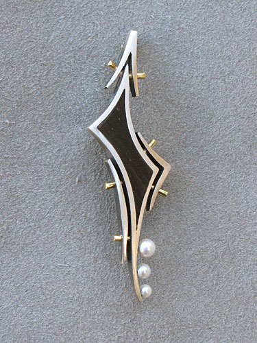 Brooch, silver and gold with ebony and pearls